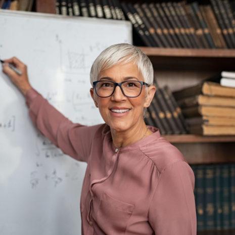 Portrait,Of,Happy,Mature,Professor,Teaching,Mathematics,To,Students,In